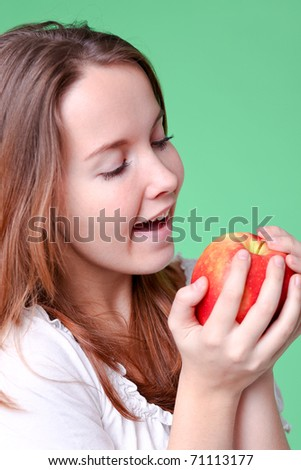 portrait of the beauty girl with red color apple in park - stock photo