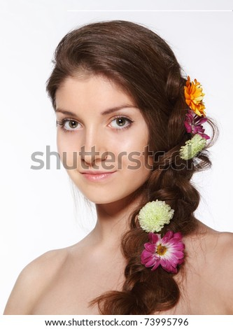 Portrait of the beauty young brunette girl with flowers in her hair