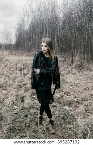 portrait of the blonde girl in the woods