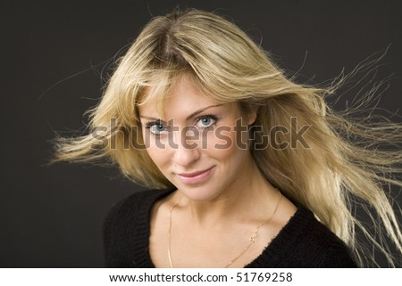Portrait of the blonde on a black background - stock photo