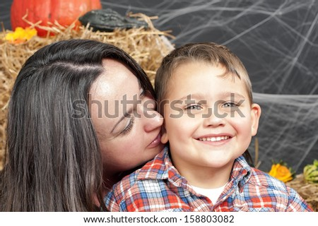 Portrait of the boy and mother during Halloween photo shoot in the studio - stock photo