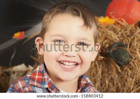 Portrait of the boy during Halloween photo shoot in the studio - stock photo