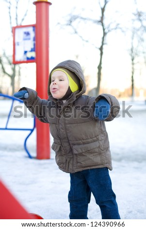 Portrait of  the boy which is teased at a playground - stock photo