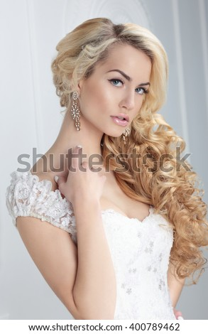 Portrait of the bride. Hairstyle, long blonde hair. - stock photo