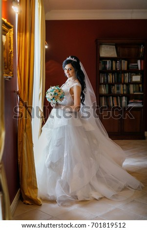 Portrait of the bride on her wedding day. A young girl is getting married. Happy bride. Woman waiting for the groom