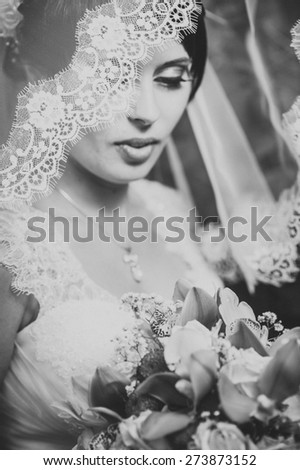 Portrait of the bride with a veil. Wedding theme