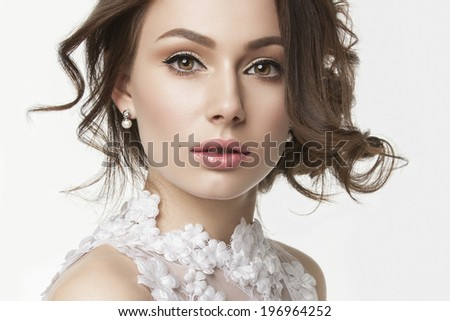Portrait of the bride with big beautiful eyes on white background
