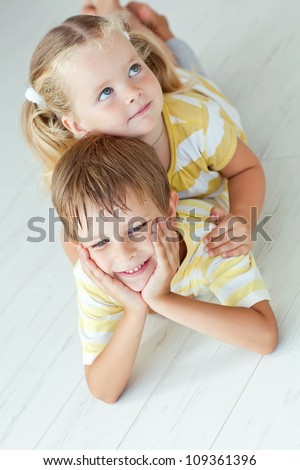 Portrait of the brother and its little sister - stock photo