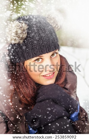 Portrait of the charming young woman in winter outdoors - stock photo