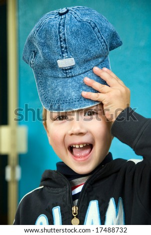 Portrait of the cheerful boy in a jeans cap - stock photo