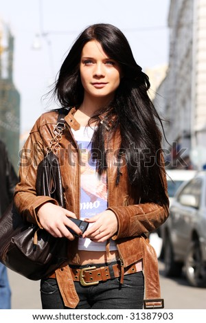 Portrait of the city girl in brown a leather to a jacket - stock photo