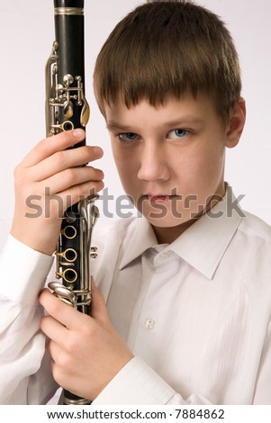 Portrait of the clarnetist with the musical instrument - stock photo