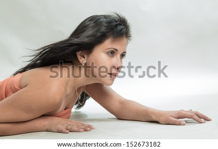 Portrait of the creeping girl - stock photo