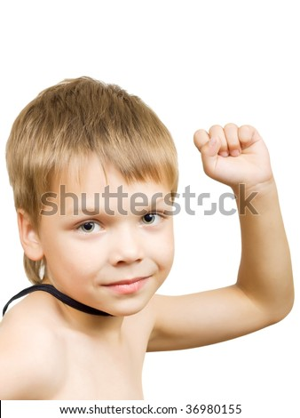 Portrait of the cute boy with a raised hand clutched in his fist, isolated on a white background
