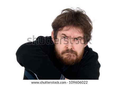 Portrait of the emotional man with a beard.Aggressive person.Isolated on a white background - stock photo