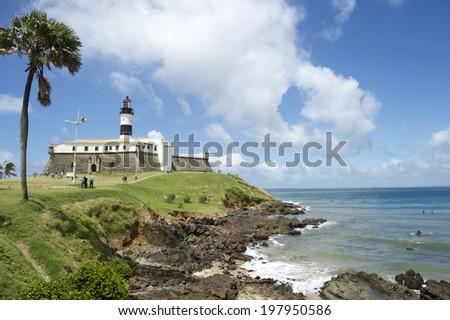 Portrait of the Farol da Barra Salvador Brazil lighthouse from the beach - stock photo