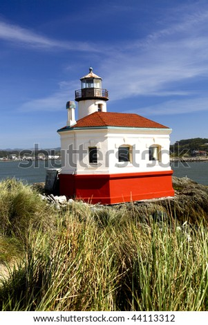 Portrait of the freshly painted Coquille River Lighthouse near Bandon on the Oregon coast. - stock photo