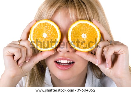 Portrait of the funny young woman with oranges. Isolated