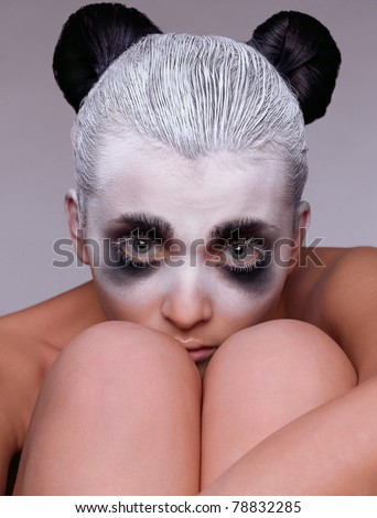Portrait of the girl close-up in an image of the  panda - stock photo