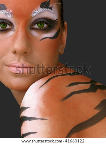Portrait of the girl close up in an image of the tiger - stock photo