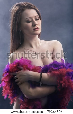 Portrait of the girl from a boa  - stock photo