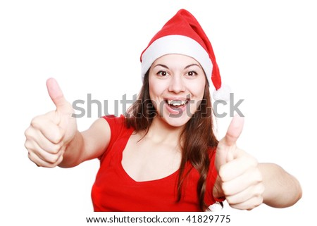 Portrait of the girl in a christmas cap and the greater finger lifted upwards.