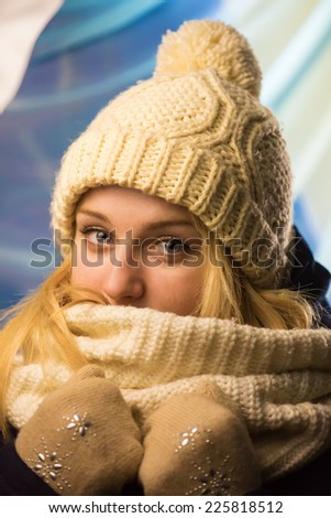 Portrait of the girl in a knitted cap - stock photo