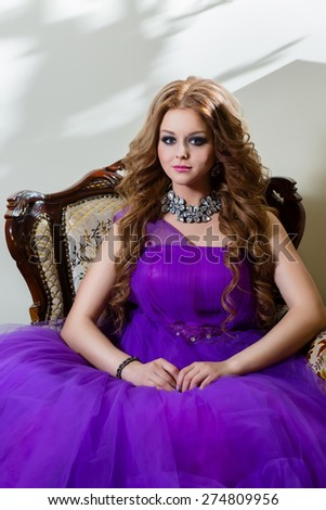 Portrait of the girl in a luxury purple dress - stock photo