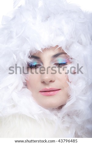 Portrait of the girl in a white boa with smart make-up