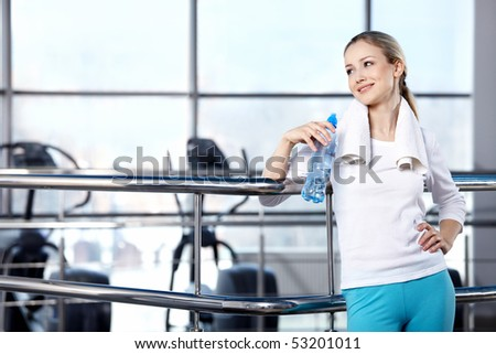 Portrait of the girl in the sports form in fitness club - stock photo