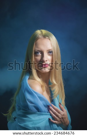 Portrait of the girl on blue - stock photo