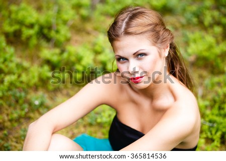 Portrait of the girl on the grass background. - stock photo