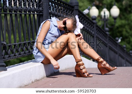 Portrait of the girl to the utmost against street - stock photo