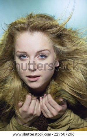 Portrait of the girl with a fur collar - stock photo