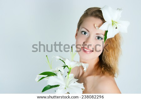 portrait of the girl with a lily flower