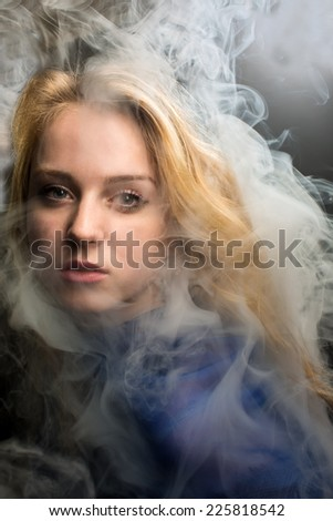 Portrait of the girl with a smoke - stock photo