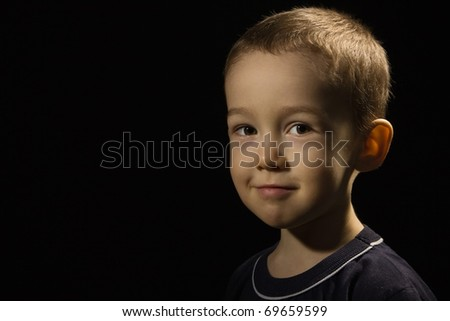 Portrait of the happy baby on a black - stock photo