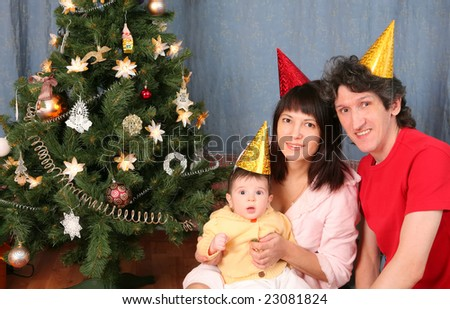 portrait of the happy family on New year holiday near decorated christmas fir trees - stock photo