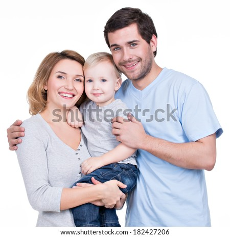 Portrait of the happy family with little child looking at camera - isolated on white background