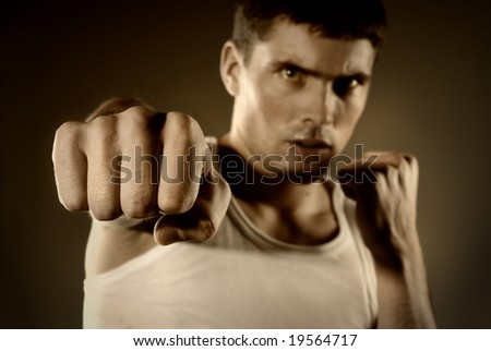portrait of the hitting fighter - stock photo