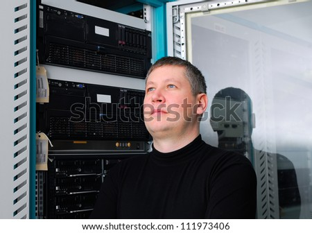 portrait of the it technician in the data center - stock photo