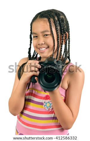 Portrait of the little girl taking a picture with a professional camera  ,isolated on white, This has clipping path. - stock photo