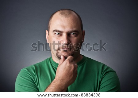 Portrait of the man against a dark background - stock photo