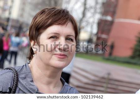 Portrait of the mature woman on the street