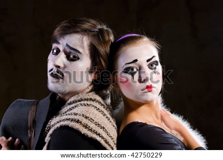 Portrait of the mime in a make-up on black background