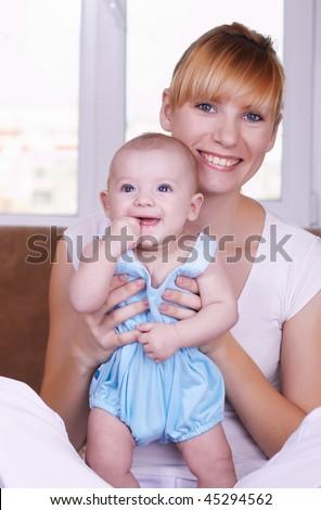 Portrait of the newborn child near to mum - stock photo