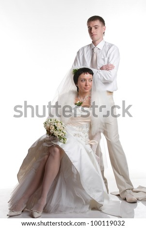 portrait of the newlyweds on studio shooting