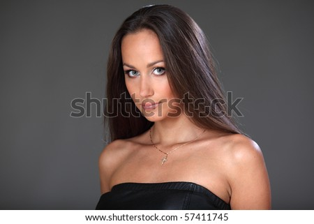 Portrait of the pretty young lady with the long, hair. - stock photo