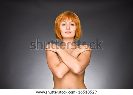Portrait of the sexual girl with red hair