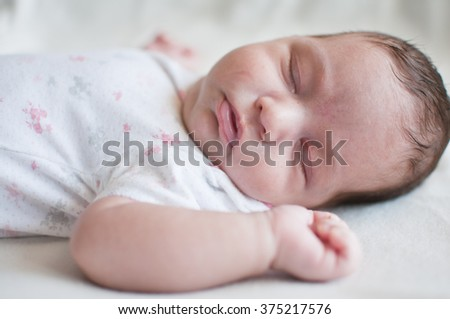 Portrait of the sleeping baby - stock photo